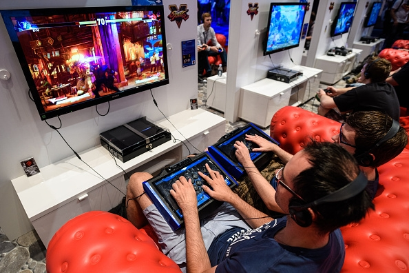 people-play-video-games-at-the-sony-playstation-stand-at-the-gamescom-2015-gaming-trade-fair-during-the-media-day-on-august-5-2015-in-cologne-germany